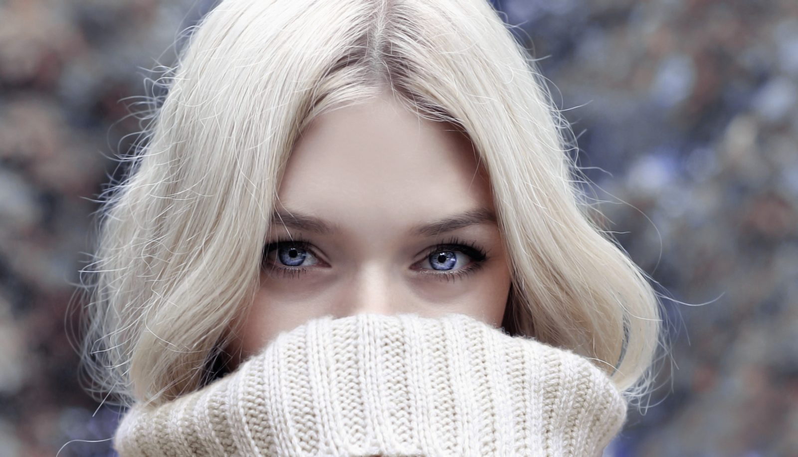 Great eyes over cowled sweater